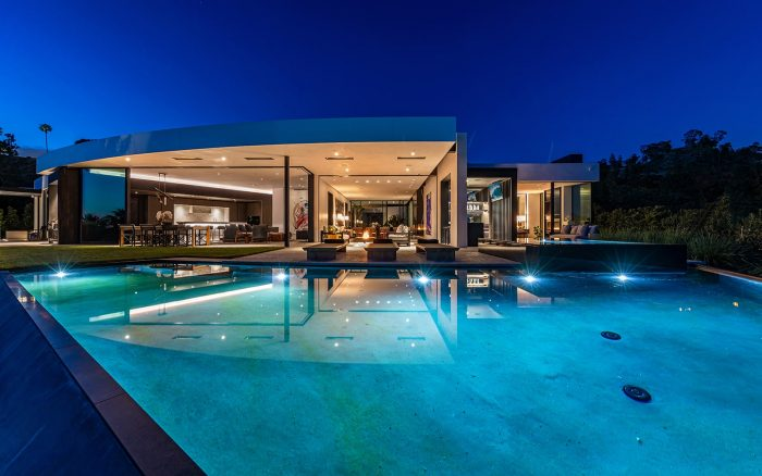 swimming pool nightime beverly hills luxury home