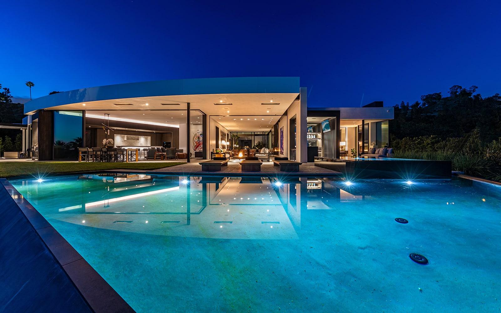 swimming pool nightime beverly hills luxury home