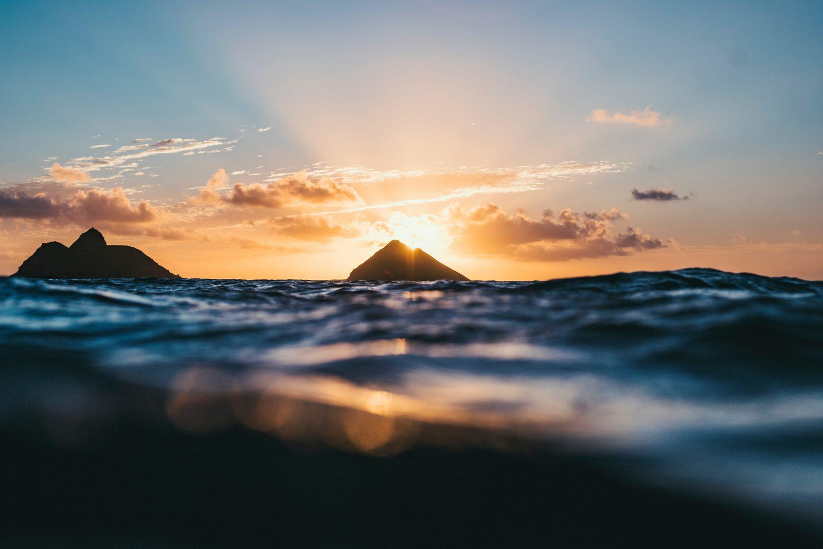 sun setting over the ocean at lanikai beach oahu
