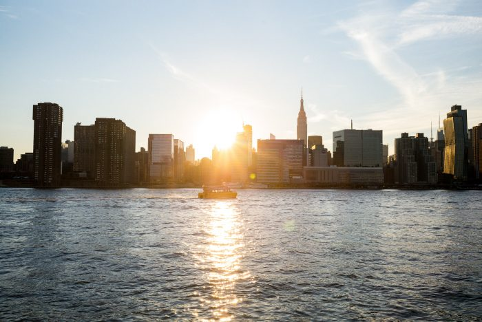 sunset over east river new york city skyline