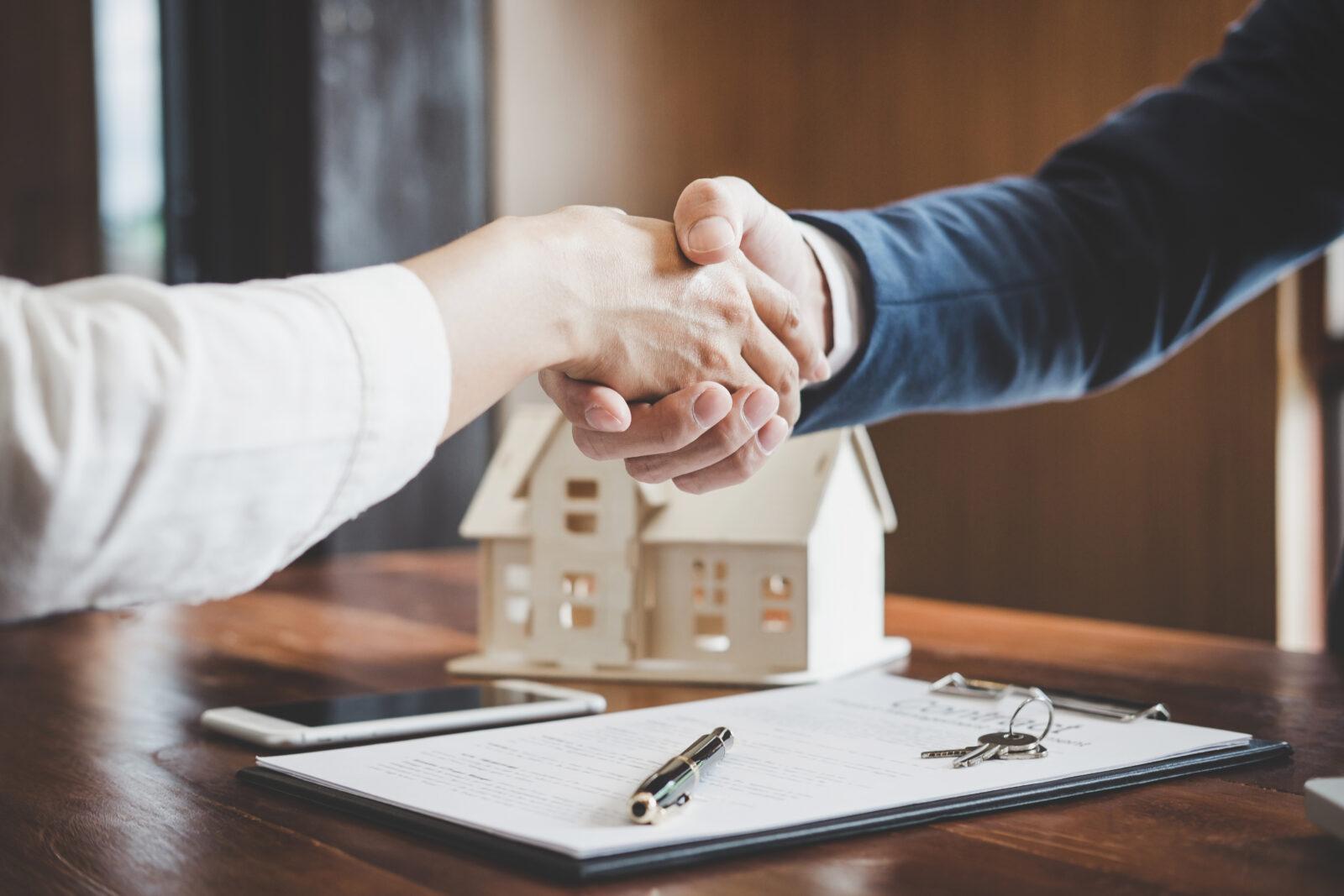 shaking hands over real estate deal