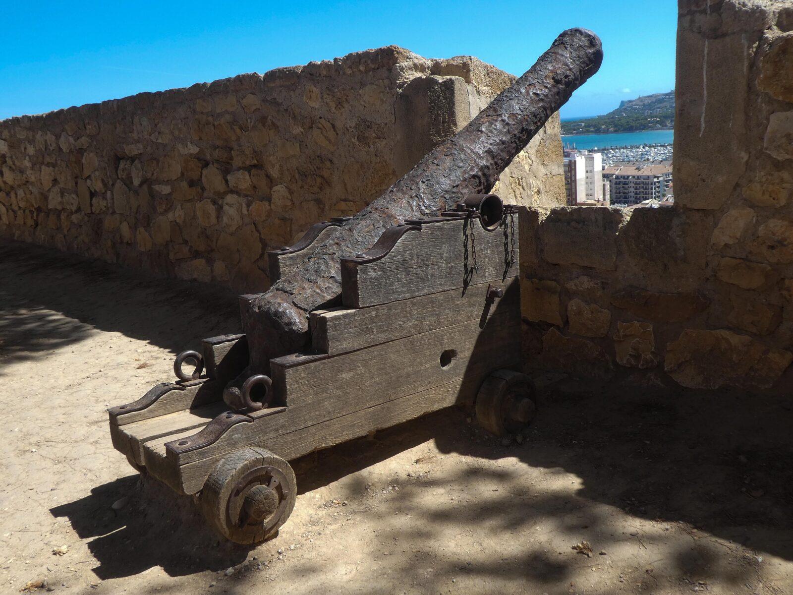 canon denia castle overlooking harbor spain