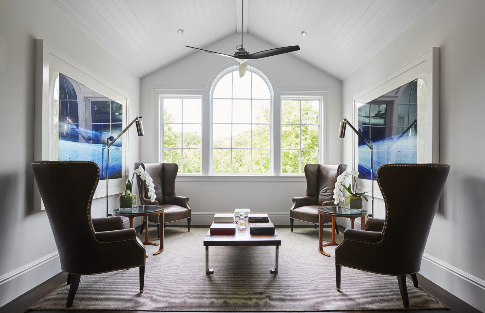 hamptons sitting room with vaulted ceilings and picture windows