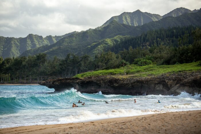 hawaii beach and oceanfront with mountains in the background