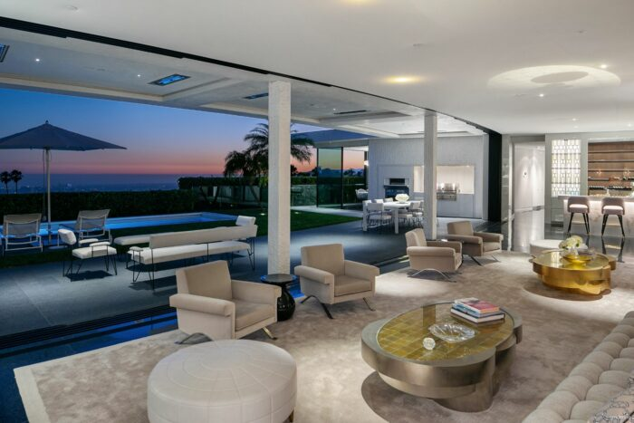 curved living room with pocketing walls of glass in trousdale