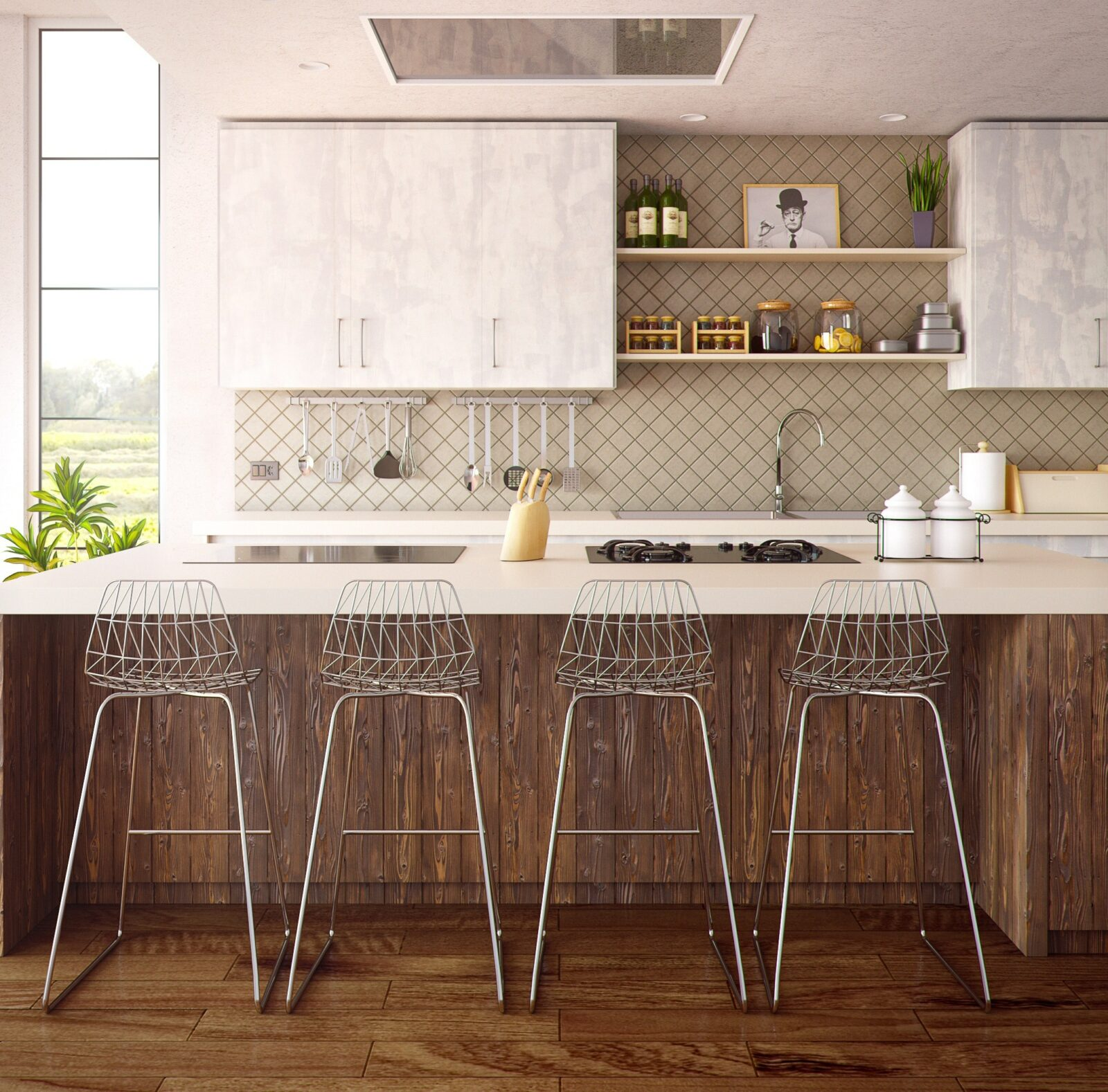 wire chairs sit at a breakfast bar in a staged chef's kitchen